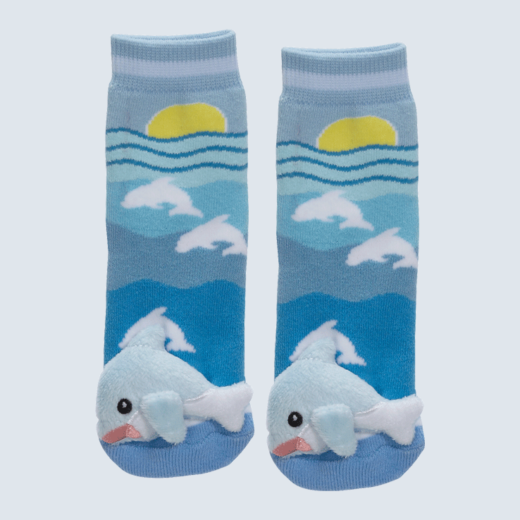 Two blue socks against a white background. The socks feature a sun and sea motif with a a plush dolphin on each toe.