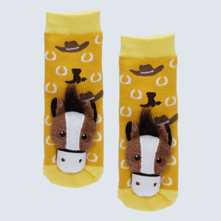Two yellow and gold socks against a white background. The socks feature a horse plush on each toe and a horseshoe and cowboy hat motif.