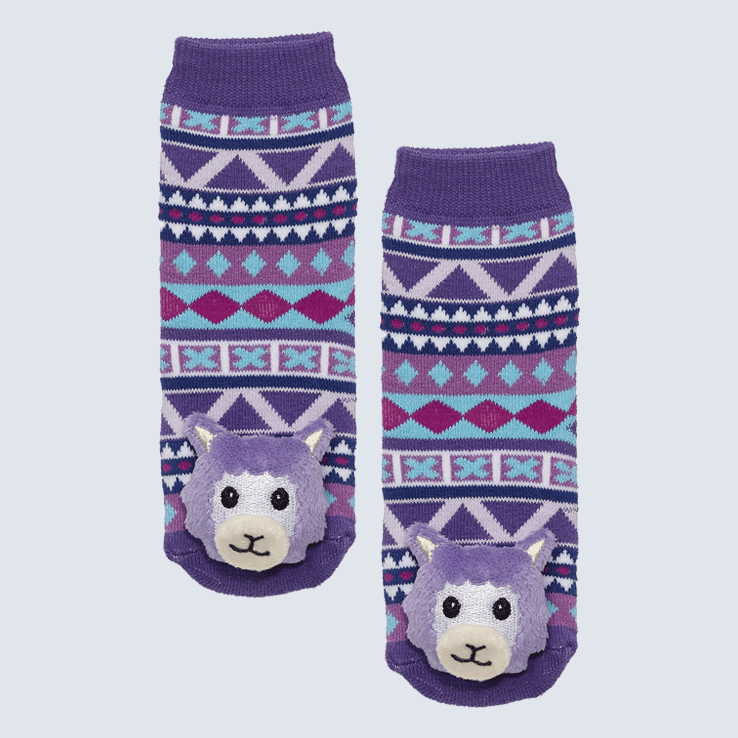 Two socks against a white background. The socks feature a purple diamond motif a cute plush llama charm on the toe.