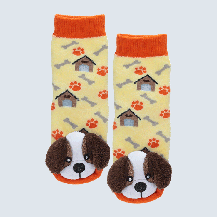 Two yellow and orange socks against a white backdrop. The socks feature a paw print and dog house pattern. Each sock has a cute plush St Bernard charm on the toe.
