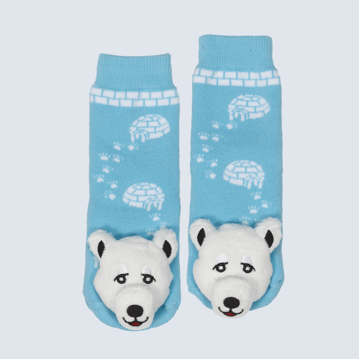 Two blue socks against a white background. The socks feature a white igloo motif and a cute plush polar bear charm on the toe.