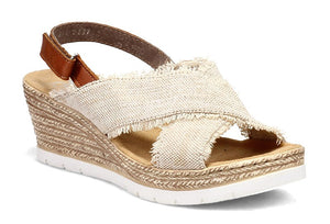 The Fanni 35 by Rieker is molded in a pattern of braided jute.  A low, lightweight wedge sandal with a velvety molded footbed features an adjustable strap for easy comfort and style.  Heel height is approximately 2 inches.