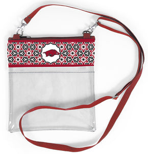 Show your Arkansas school spirit with this crossbody handbag. Breeze through security with this tech friendly crossbody with floral pattern and team logo.