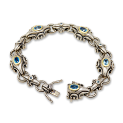 Sterling Silver Blue Topaz Bracelet with 18K Gold Accents