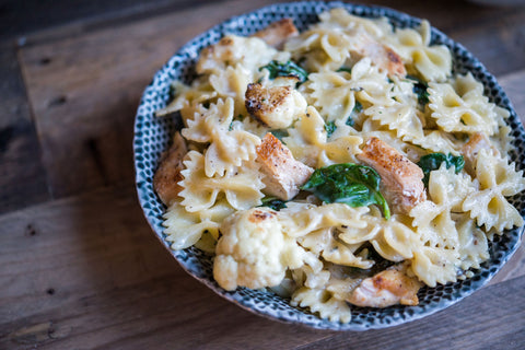 Cauliflower, Kale & Spinach Farfalle in a Gruyere Oregano White Sauce (w/ option to add Garlic Chicken!)