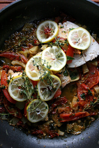 Chardonnay Poached Halibut or Chicken w/ Sun-dried Tomatoes, Fennel and a Crunchy Olive Topping