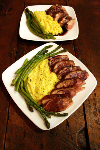 Pan Seared Duck Breast w/ Goat Cheese & Oregano Polenta, a Red Wine Reduction and Asparagus Sautèed in Duck Fat