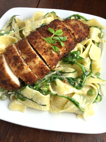 Pappardelle Milanesa w/ Pea Shoots and Arugula in a Lemon Basil Wine Sauce and Choice of Protein