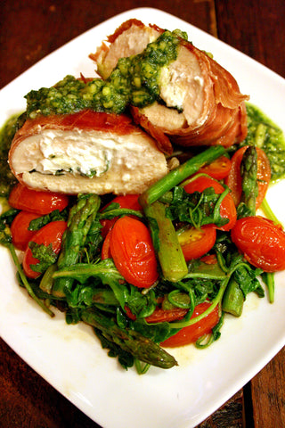 Herb and Goat Cheese Stuffed Prosciutto Wrapped Chicken Breast w/ Tomato, Asparagus & Arugula Saute and Basil Almond Pesto