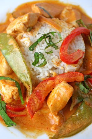 Panang Curry with Peppers and Snow Peas over Green Tea Rice with Choice of Chicken, Shrimp or Tofu