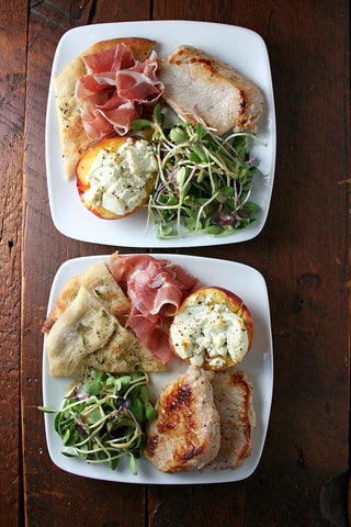 Peaches 'n Pork - Roasted Peaches Stuffed w/ Goat Cheese,  Prosciutto, Herb Brined Pork Loin, Organic Spring Mix Salad & Rosemary Focaccia