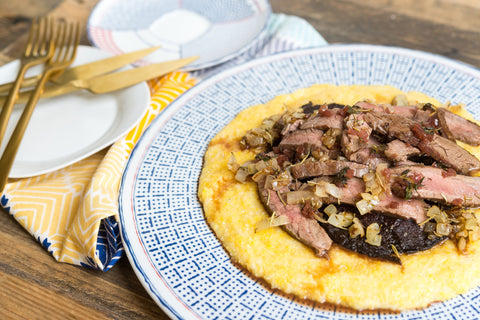 Flank Steak & Roasted Portabella w/ Caramelized Onions and a Red Wine Reduction over Gruyere Polenta