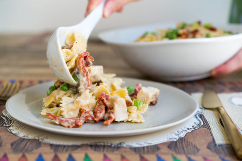 Roasted Garlic, Parmesan & White Wine Farfalle w/ Sun Dried Tomatoes, Pancetta, Mushrooms & Peas and Choice of Protein!