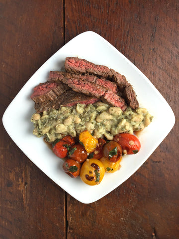 Marinated Skirt Steak w/ Blistered Balsamic Tomatoes and Pesto Cannellini Beans