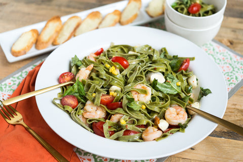 Spinach Fettuccine and Choice of Protein w/ Fresh Mozzarella, Basil, Cherry Tomato, Sweet Corn, Pancetta and a Parmesan Crostini