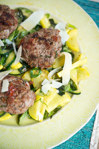 Sun-dried Tomato and Portobello Turkey Patties over a Blackened Summer Squash and Herb Salad
