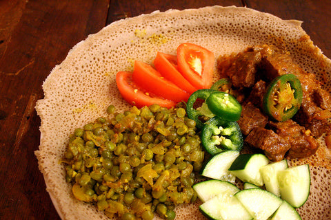 Ethiopian Awaze Beef Tibs w/ Kik Alicha (Stewed Split Peas), Veggies and Fresh Injera