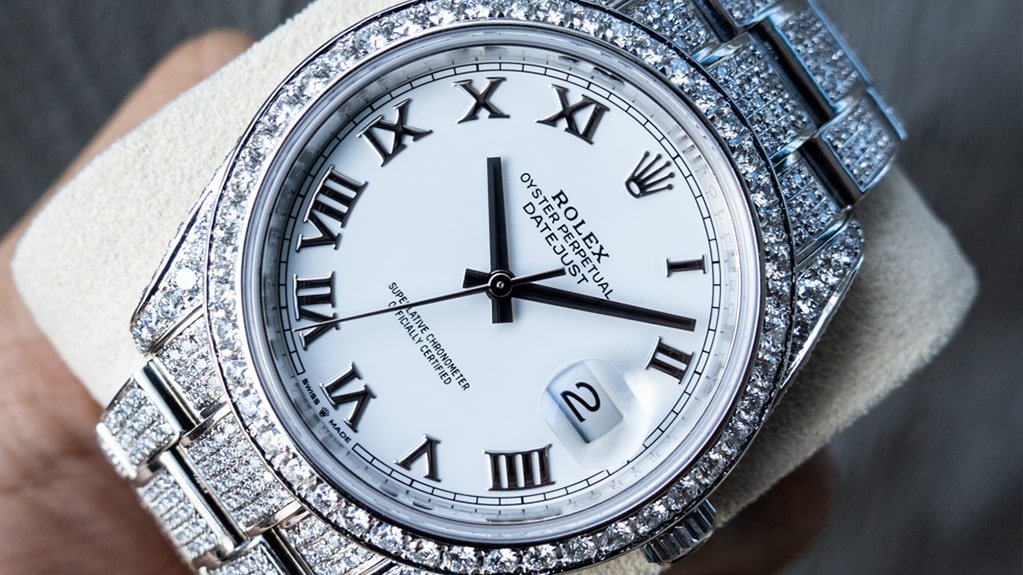 white rolex datejust which has been custom diamon set by Cagau