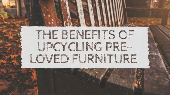 Sign on tree saying The Benefts of Upcycling Pre-Loved Furniture