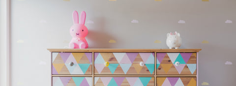 Child's dresser with a bunny and pig resting on top