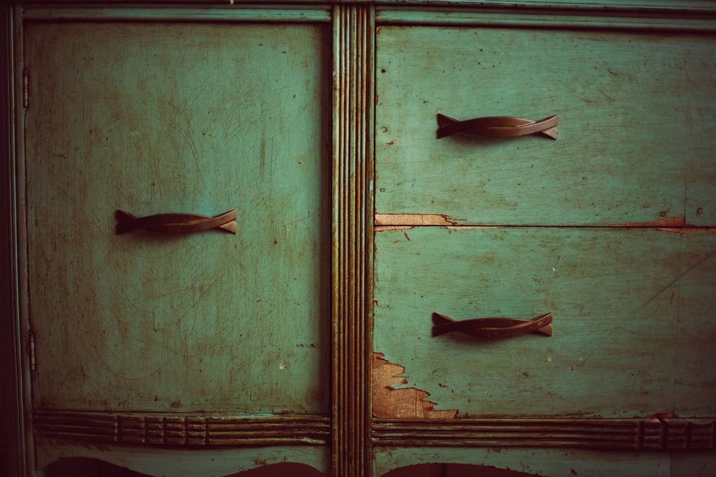 Photo of the patina of an old dresser covered with a stain