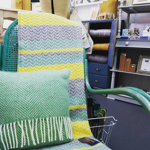 Quilted afghan and matching pillow on a rocking chair up-cycled with Anne Sloan Chalk Paint