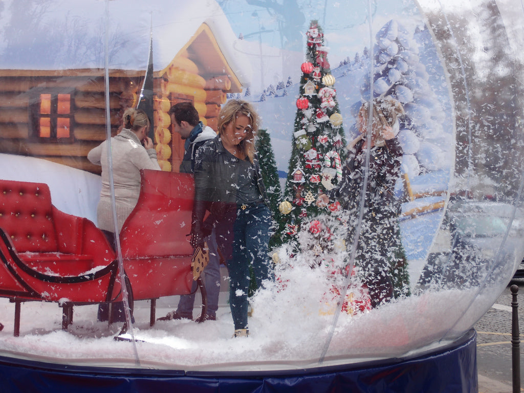 Woman reflected in a snowglobe