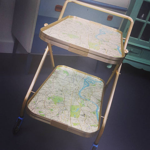 A wheeled drinks tray with a map used for the lining