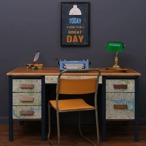 Image of a 60's inspired desk with a typewriter on the desk.