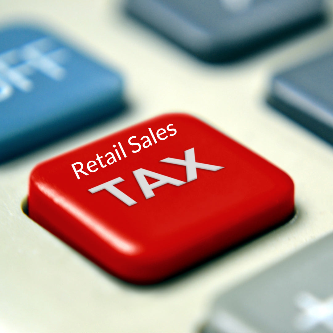 Calculator key labeled retail sales tax