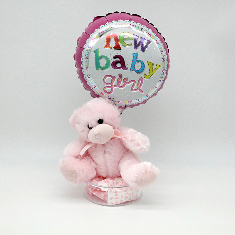 Balloon, teddy bear, and dish of candy