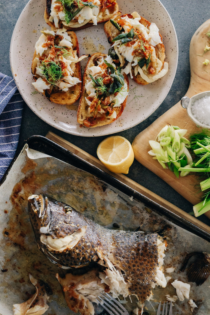 Whole baked coral trout toasts