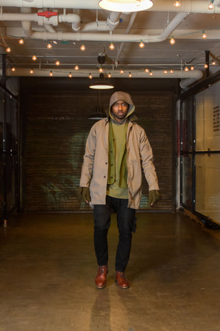 mercerized cotton mac coat, work cardigan made with re-used army tarp, hooded shirt of ponte, black bull denim trousers
