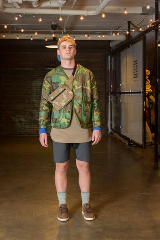 work cardigan of re-used army blanket, bum bag made of moroccan rug, gaberdine shorts and neoprene shirt