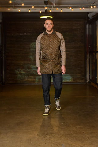 quilted nylon and mercerized cotton sleeved mac coat, raw denim trousers.