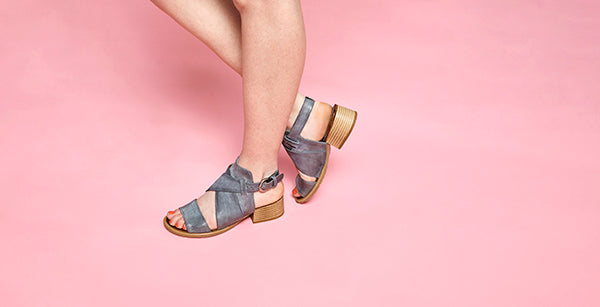 Women modeling Fiji sandals in sky colour