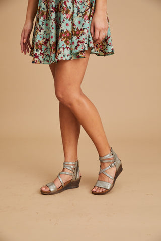 Lifestyle Image of Shay Metallic Wedge Sandal