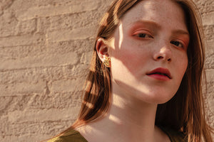 Model wearing Marsel Malpelo Earrings
