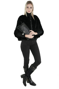 Woman with black python clutch handbag from Sherrill Bros