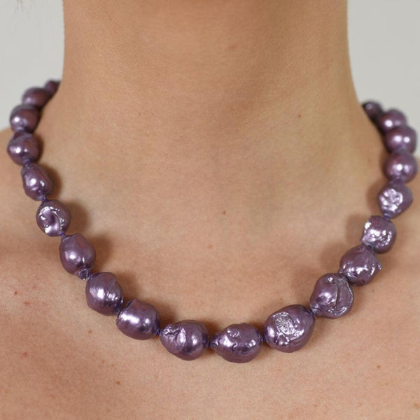 Rhodium.p silver w purple pearls