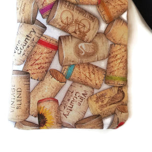 close up of print uncorked cell phone or sunglass pouch