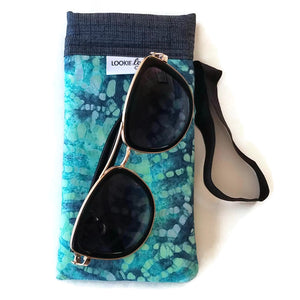 sunglasses on top of teal batik cell phone or sunglass pouch