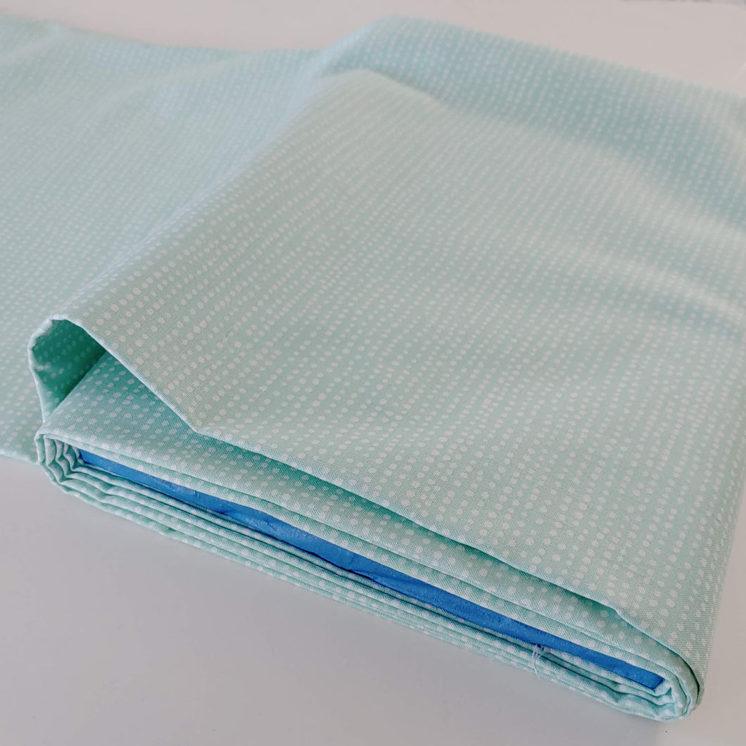 White dots on Aqua fabric