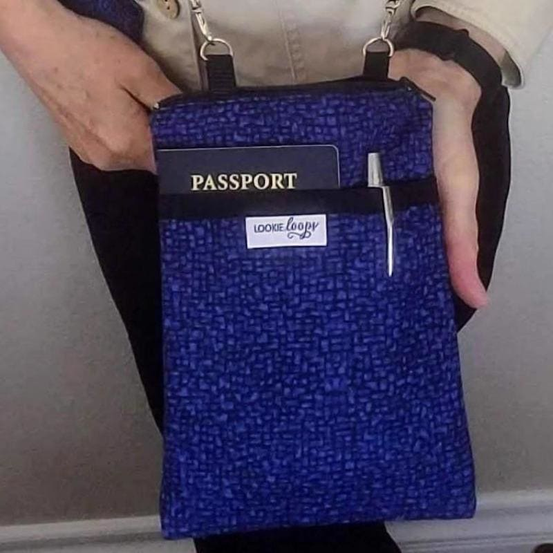 Cobalt blue zippered crossbody bag with pockets for pen lipstick passport phone - front view