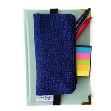 Load image into Gallery viewer, bedrock cobalt pencil pen glasses case on journal with pens - front view