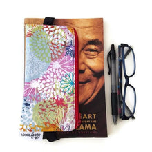 Load image into Gallery viewer, Floral pattern pen pencil or glasses pouch attached to book - front view with glasses