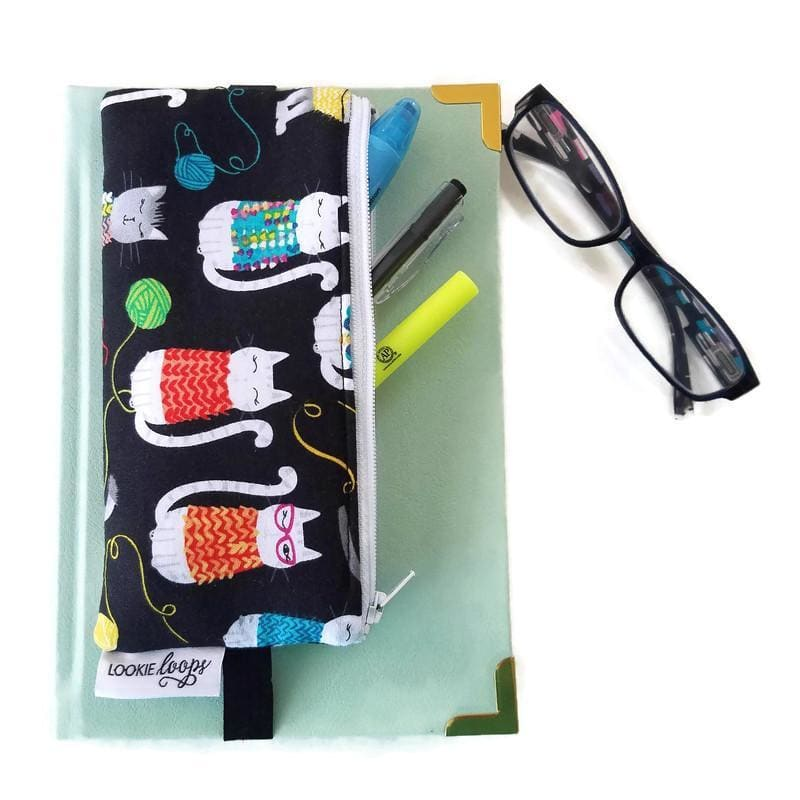 Whimsical cat pattern pen pencil or glasses pouch attached to journal - front view showing pens and glasses
