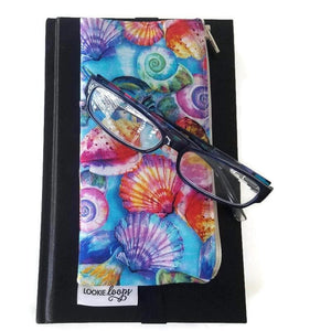 Vibrant shell pattern pen pencil or glasses pouch attached to journal - front view showing glasses
