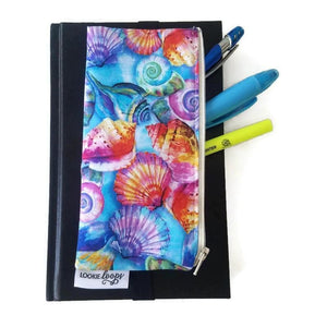 Vibrant shell pattern pen pencil or glasses pouch attached to journal - front view showing pens
