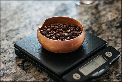 Coffee Beans Getting Weighed On Weighing Scale